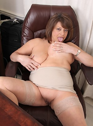 Busty brunette Penny Beavers spreads wide in her brown office chair