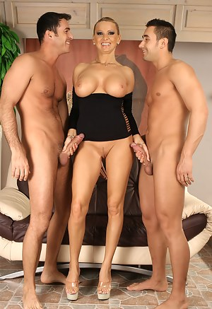Let sensational madam show you her awesome fuck skills. Her partners are kissing her big tits and drilling her sweet holes hard.