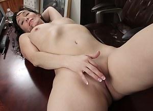 Mature office babe Shelly Jones naked on her desk.