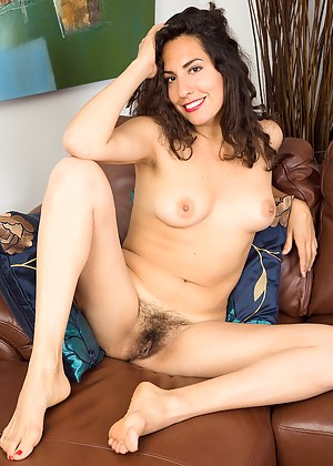 Next door housewife Isabelle spreads her hairy beaver on the couch