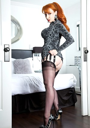 Getting dressed up to paint the town Red in My new sparkly dress and designer shoes - not to mention My trademark red pout - got Me so horny I decided to stay in and treat you to a saucy striptease and finger fucking session instead!