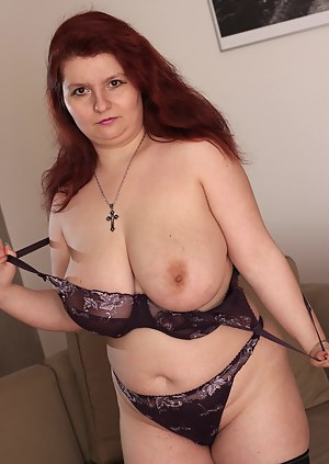 Big breasted mature slut getting naked