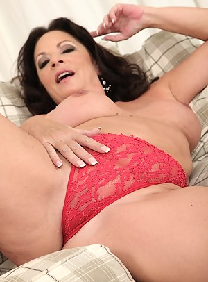 Busty mature wife Margo Sullivan naked in only red heels.