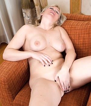 Naughty blonde housewife spreads her sweet pink twat