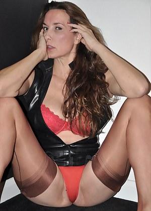 Gorgeous red panties look amazing as they hug Nylon Janes figure.