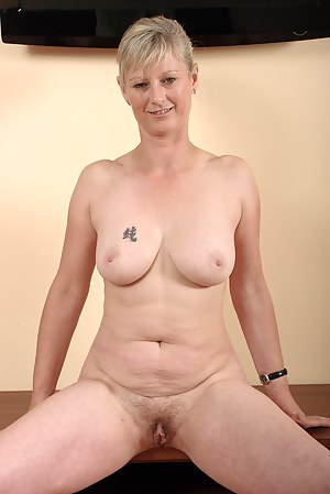 Horny 42 year old blond Nicole M strips after getting home from work