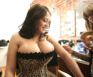 Busty Leanne in leopard corset pose for the camera