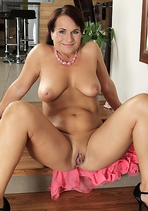 Big titted curvy mature babe Katherine Ross strips.