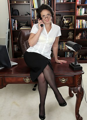 Horny and exotic Calita Johnson opens her legs wide on the desk