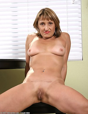 Jillian strips out of her clothes and shows her 49 year old pussy