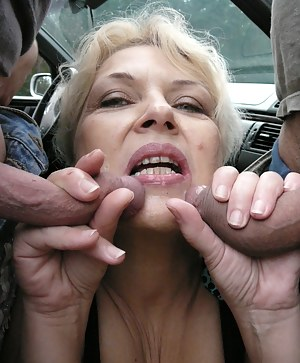 This horny slut loves two cocks in the car