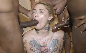 This tattooed slutty woman LOVES nothing more than a cock in her ass.... but thankfully she ALSO enjoys a face full of cum too!