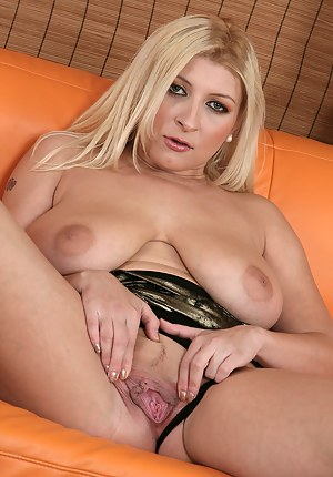 Blonde and busty Leandra gets naked and spreads her pussy wide