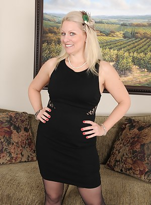 Cute blonde 36 year old Zoey Tyler spreads her stocking clad legs