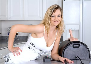 Lovely Nicole Logan gets sybian fucked on top of the kitchen counter while completely nude