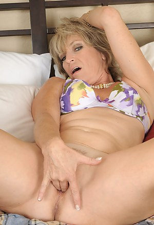 49 year old Tina from AllOver30 fingering her mature pussy for you