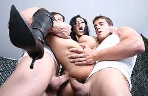 Powerful army men are fucking the busty brunette wearing military uniform. They are presenting her with rough double penetration.