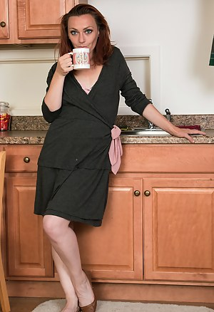 Petite 33 year old Amber K from AllOver30 gets herself hot in the kitchen
