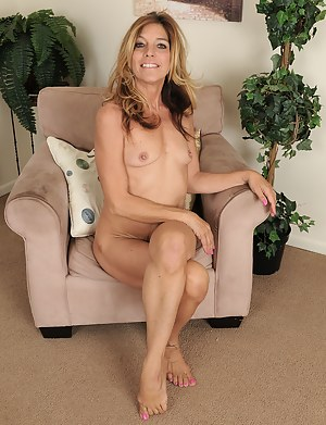 51 year old Monique slips off her sexy lingeries to spread wide here