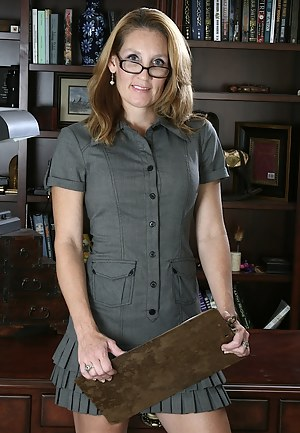 Gorgeous older secretary Lilly gets naked in the office.
