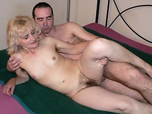 See this blonde granny get nasty on that throbbing cock