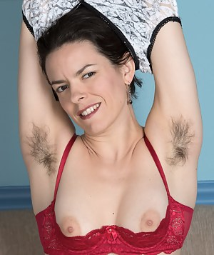 Lucia stands in her sexy top and blue denim jeans. She slowly strips to a rose thong and pulls it down. Naked, her hairy pussy is shown off and sexy. Lucia has sexy hairy pits and a thick hairy beaver.