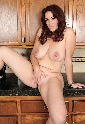 Brunette housewife Ryan takes a break to pull her mature pussy open
