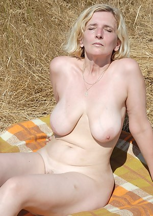 Horny and hairy Hillary from AllOver30 shows off her beaver oustide
