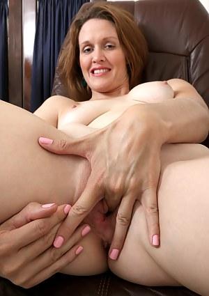 Horny teacher strips down and finger fucks her wet pussy