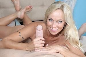 Horny blonde MILF Dani rubbing throbbing cockhead