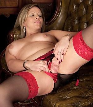 Office MILF Louise Pearce gets naked on her desk.