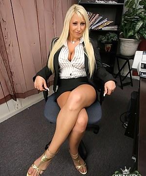 Extraordinary upskirt shots of marvelous pussy and fake tits of great Candy Manson right before she gets pounded hardcore in the office.