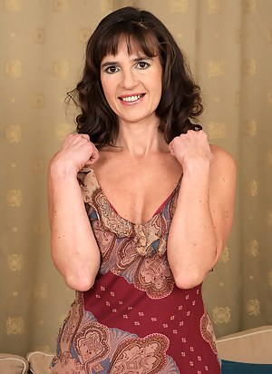 47 year old Suzie from AllOver30 sheds her dress and spreads her pussy