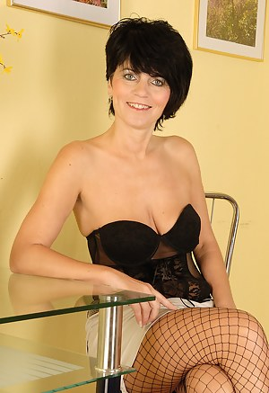 Elegant looking Eve in fisnet stockings bares her fine mature ass