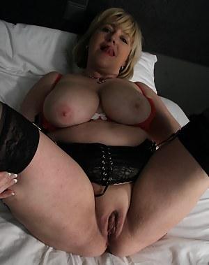 Big breasted mature slut getting naughty