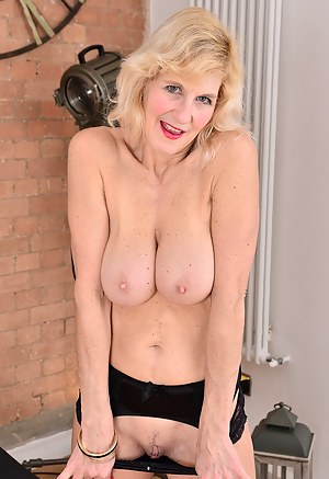 Sultry blonde Molly Maracas loves showing off her sexy black lingerie