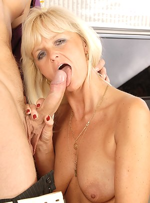 MILF Jenny F first gobbles and then fucks her young studs hard cock