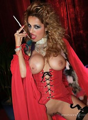 Big boob curly hair smoking babe in red lingerie masturbates