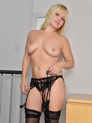 Blonde sexpot Sophie May strips down on top of the dresser