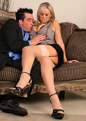 Stunning MILF with big fake tits does a first class blowjob in her astonishing stockings right before being nailed hardcore with a big cock.