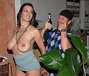 Sweet woman is going mad about big cock of this horny man. She is covering his aggregate with alcohol and sucking this boner.