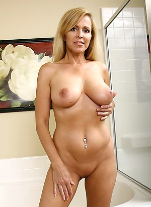47 year old busty blonde spreads her legs and plays with her feet