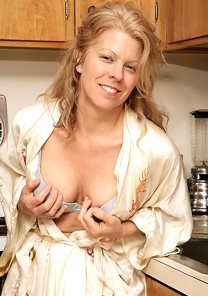 Blonde mature housewife Lauren E gets down and dirty in the kitchen