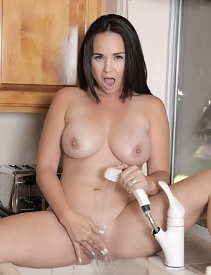 Holly West gets naughty and sprays her throbbing pussy