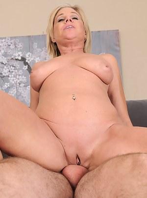 Gorgeous blonde MILF Payton Hall sucks and fucks her man