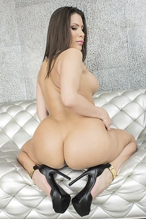 Wonderful brunette is getting her wide ass hole penetrated with the black toy. She is also practicing anal sex with her man on the silver sofa.