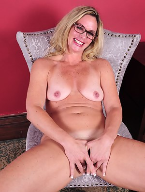Naughty American housewife playing with her pussy