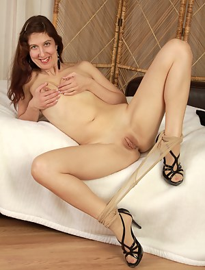 Long haired 32 year old Valentine strips off her nylons to expose pink