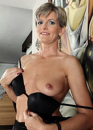 Elegant older babe Melanie spreads her tight ass.