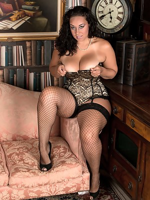 Busty brunette plays with her big tits and tight shaved twat
